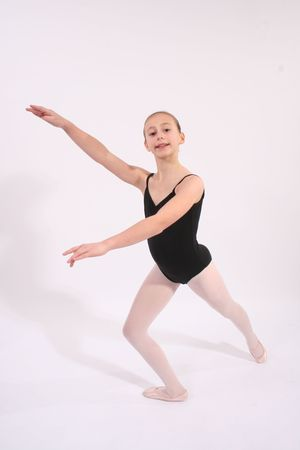 Young ballerina in black leotard and white tights photo