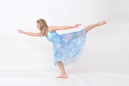 lyrical: Girl in blue lyrical dress arabesque Stock Photo