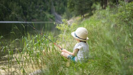 Child Fishing On A Sunny Day
