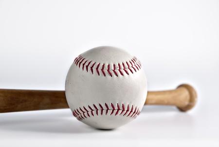 Macro of baseball with bat on white background