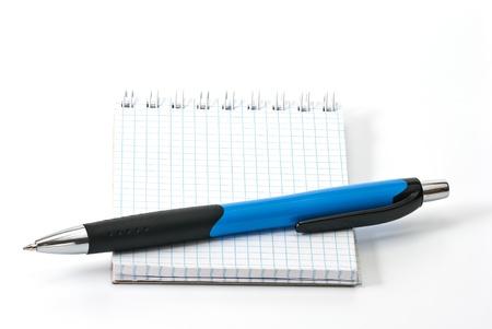 ballpen: Blue ballpen on small notebook, isolated on white background