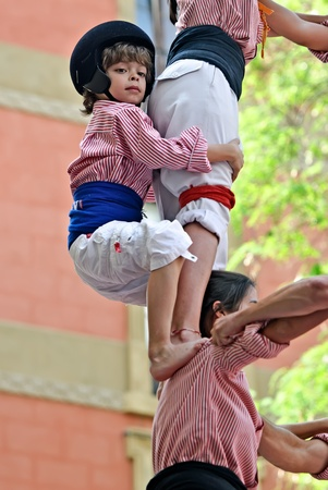Barcelona, Spain - May 8, 2011 - Castellers of Tarragona building traditional human tower Editorial