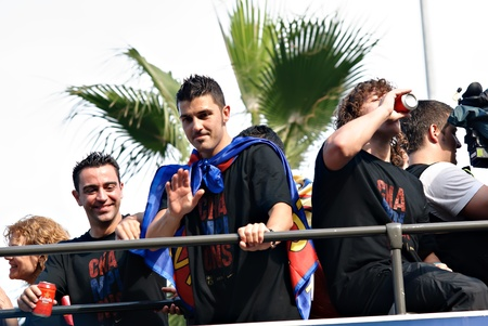 xavi: FC Barcelona players celebrate their 4th UEFA Champions league title on top of an open bus during a parade during the streets of Barcelona, Spain on May 29, 2011 one day after winning the final match against Manchester United at Wembley Stadium London, UK