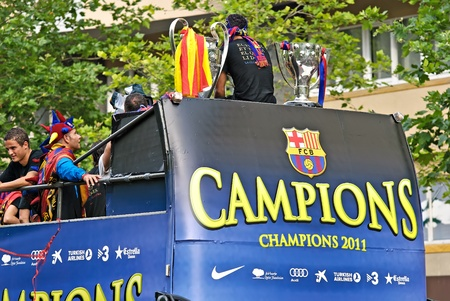 wembley: FC Barcelona players celebrate their 4th UEFA Champions league title on top of an open bus during a parade during the streets of Barcelona, Spain on May 29, 2011 one day after winning the final match against Manchester United at Wembley Stadium London, UK