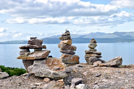 steadiness: stacks of stones overlooking irish atlantic coast Stock Photo