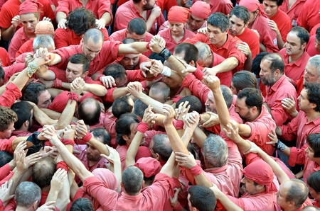 Members of Castellers de Barcelona build the base of traditional human tower at the Placa de Sant Jaume during the Mercé 2011 on September 25, 2011 in Barcelona, Spain.