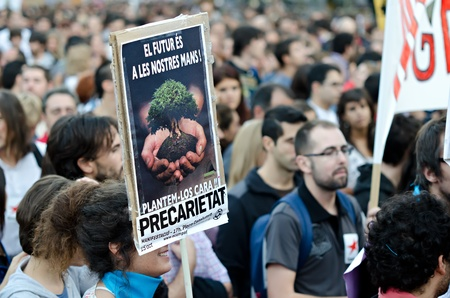 mobilization: BARCELONA, SPAIN - OCTOBER 15: More than 200.000 of citizens mobilize against the alliance between politicians and the financial elites and for a global change on October 15, 2011 in Barcelona, Spain.