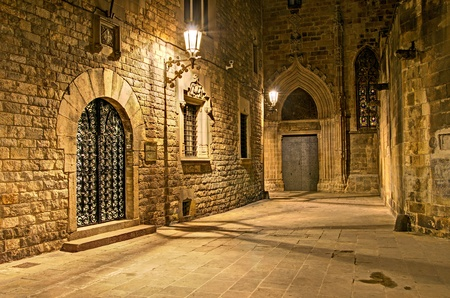 and streetlights: gothic quarter, Barcelona, Spain - nightly lane behind the gothic cathedral Stock Photo