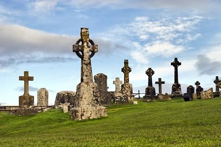 Rock of Cashel, Ireland - celtic crosses at graveyard Editorial