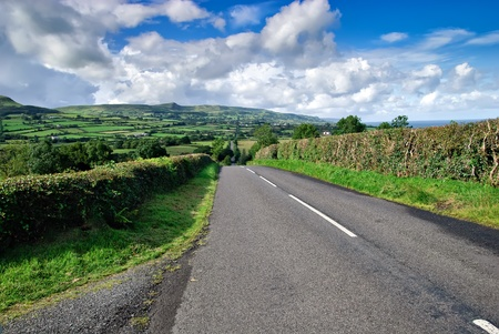 endless irish road, crossing the hills of northern Ireland Stock Photo