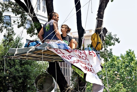 displaced: Protestors for real democracy and a system change in Spain sitting at Plaza Catalunya, Barcelona, Spain on 27052011 after they have been temporarily displaced by a massive police intervention