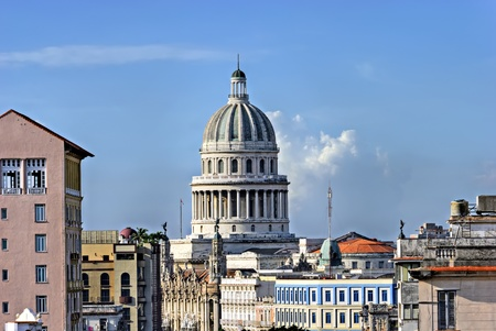 capitolio: The cupola of the El Capitolio, or National Capitol Building in Havana, Cuba, former the seat of government and today the home to the Cuban Academy of Sciences seen from a roof in the Prado Editorial