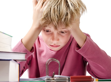 despaired: desperate boy doing is homework - isolated on white background Stock Photo