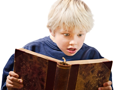 blonde boy: young boy reading excited in an old book