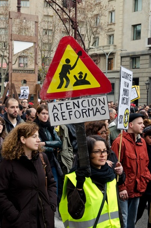 demonstrator: BARCELONA, SPAIN - FEBRUARY 19: hundreds of thousands of people across Spain demonstrate against the conservative governments new labor laws. Passeig de Gracia on February 19, 2012 in Barcelona, Spain