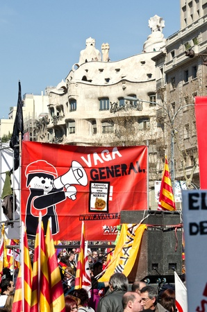 demonstrator: BARCELONA, SPAIN - MARCH 11, 2012: Thousands of protestors demonstrated at Passeig de Gracia in Barcelona to take part of the massive demonstrations with tens of thousands of participants across Spain against the conservative governments new labor laws