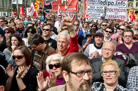 BARCELONA, SPAIN - MARCH 11, 2012: Thousands of protestors demonstrated at Passeig de Gracia in Barcelona to take part of the massive demonstrations with tens of thousands of participants across Spain against the conservative governments new labor laws