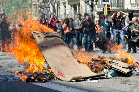 BARCELONA, SPAIN - MARCH 29: One of the multiple fires caused by heavy riots during nationwide spanish general strike against labour reforms in the city center of Barcelona on March 29, 2912.