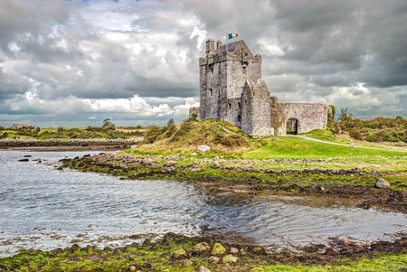 Dunguaire Castle, is a 16th-century tower house on the southeastern shore of Galway Bay in County Galway, Ireland, near Kinvarra Kinvara Stock Photo