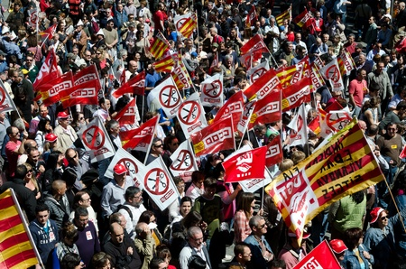ugt: Thousands of people celebrate International Workers Day with a May Day demonstration against the recent cuts and for work, rights and dignity in the city center of Barcelona, on May 1st, 2012