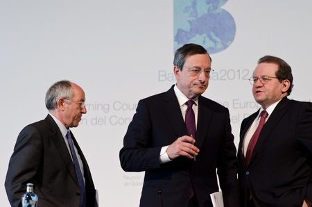 Miguel Fern�ndez Ord��ez, Mario Draghi and V�tor Const�ncio at the press conference following the Governing Council meeting of the ECB in Barcelona. Stock Photo - 13512115