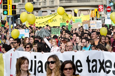Tens of thousands of Indignados from various collectives and locations hold a peaceful demonstration against social cuts and bank bailouts in Barcelonas city center on the first anniversary of the 15M movement on May 12th, 2012.