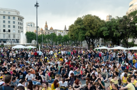 epicenter: After a peaceful manifestation of several thousand Indignados filled the Plaza Catalunya, the epicenter of the 15M movement, activists hold an assembly and prepare to hold the space until the 15th of May, in Barcelona, Spain on May 12th, 2012.