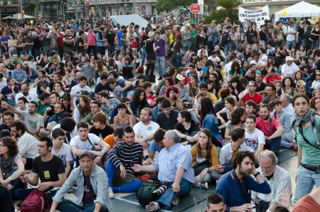 activists: After a peaceful manifestation of several thousand Indignados filled the Plaza Catalunya, the epicenter of the 15M movement, activists hold an assembly and prepare to hold the space until the 15th of May, in Barcelona, Spain on May 12th, 2012.