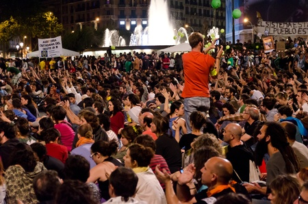 indignados: After a peaceful manifestation of several thousand Indignados filled the Plaza Catalunya, the epicenter of the 15M movement, activists hold an assembly and prepare to hold the space until the 15th of May, in Barcelona, Spain on May 12th, 2012.