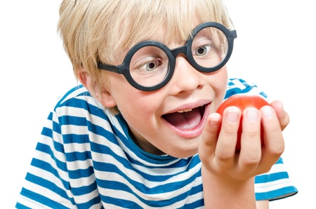blond boy: cute blond boy with tomato
