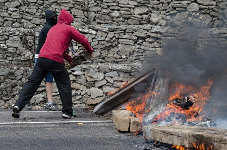 demonstrators: Striking miners barricade a national street and railway to protest against budget cuts in the coal industry and the shut down of the mines on June 19th 2012 in Ciñera, Spain