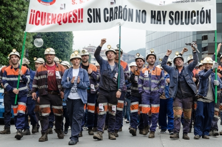 protestors: About 25,000 miners and residents of the miners zone of Asturias demonstrate against close-downs and financial cuts in the carbon sector on June 18th, 2012 in Langreo, Spain