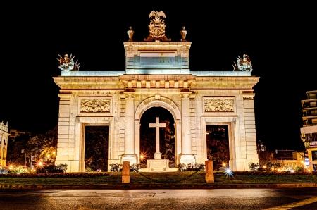 town gate  Porta de la Mar , Valencia, Spain at night Stock Photo