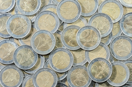 background of a multitude of 2-EURO coins Stock Photo