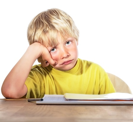 despaired: desperate boy doing his homework - isolated on white background