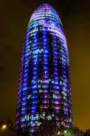 torre: Barcelona, Spain. 12th December 2012: The Torre Agbar pictured lit up for the Christmas season with more than 4,500 lights that can operate independently using LED technology displaying a seasonal design out of moving lights and colors
