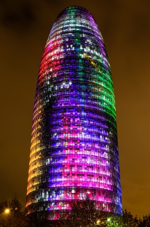 Barcelona, Spain. 12th December 2012: The Torre Agbar pictured lit up for the Christmas season with more than 4,500 lights that can operate independently using LED technology displaying a seasonal design out of moving lights and colors