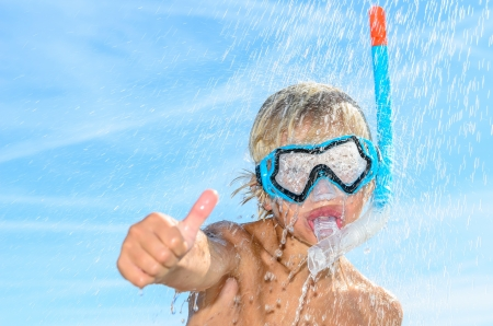 blonde boy with snorkel and diving mask thumb up