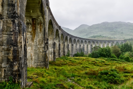 jacobite: The Glenfinnan Viaduct is built on twenty-one arches, Scotland, UK