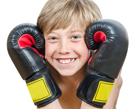 smiling young blond boy with boxing gloves