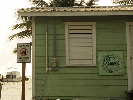 The go slow sign symbolizing the lifestyle on Caye Caulker, Belize 免版税图像