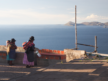 Bolivian women in traditional dress at Lake Titicaca