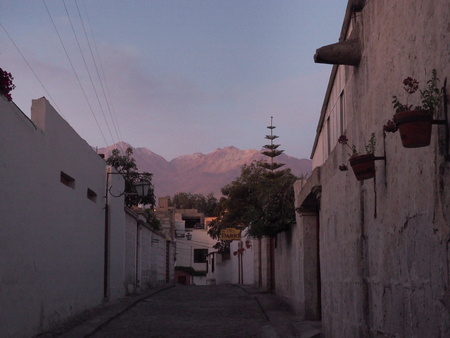 Colonial street of Arequipa with Chachani volcano background, Peru