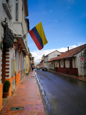 Street of la Candelaria in Bogota with colombian flag, Colombia