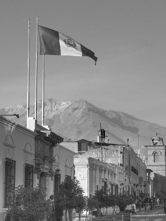 Flag of Peru in Arequipa with background of Chachani volcano