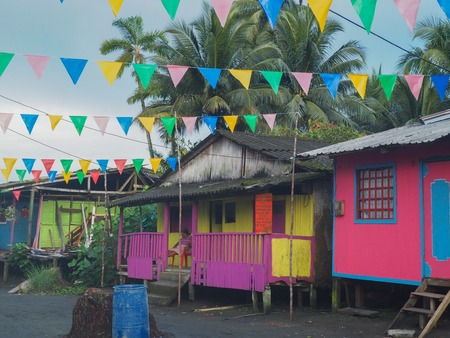Wooden colorful beach houses in Juanchaco, Colombia