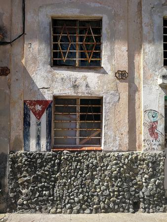 Cuban flag on house wall in Havana, Cuba