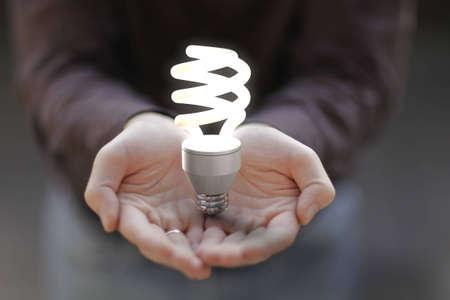 Light bulb on hands.