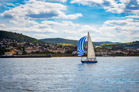 Sailboat on the rhine in front of the city Bingen.