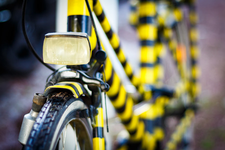 Black and yellow painted retro bicycle.
